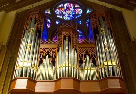 hymn: The intricate case and pipework of a beautiful church organ Stock Photo