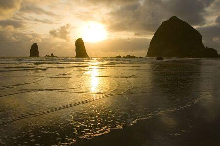 A golden sunset at Cannon Beach, Oregon photo