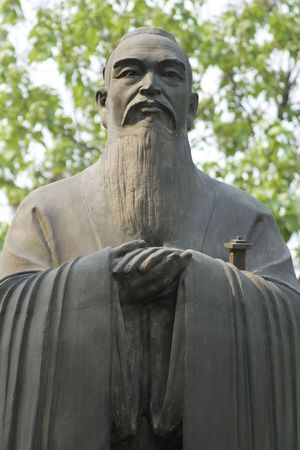 An ancient statue of Confucius photo