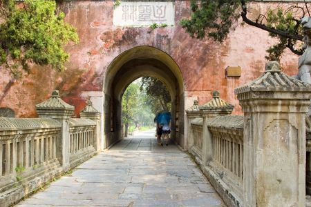 An arched entrance to a Chinese temple ground Stock Photo
