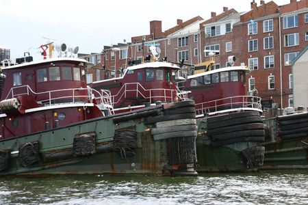 Three old Tugboats docked in Portsmouth, New Hampshire Stock Photo