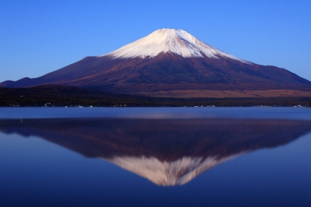 with reflection: Pre-dawn view of Mount Fuji with mirror reflection in lake