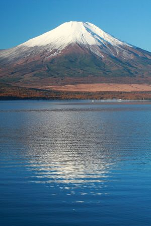 snow capped: Snow-capped Mt. Fuji in Fall with reflections in mountain lake