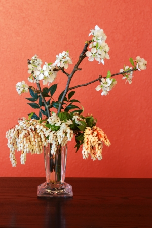 A glass vase full of garden blossoms photo