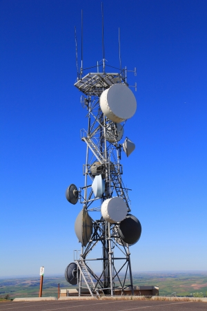parabola: A Microwave Tower with flat parabola on a mountaintop