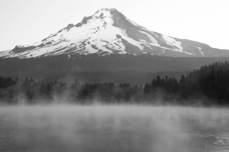 Early morning mist rising on Lake with snow-capped Mount Hood photo