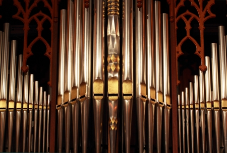 organ: Beautifully ornate prospect pipes from a tracker organ Stock Photo