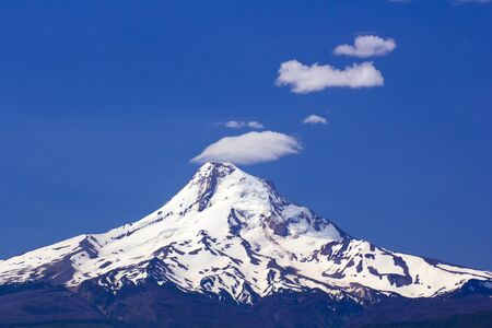 Close up of Mount hood with Smoke Stack Clouds photo