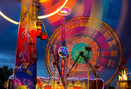 rides: Colorful nighttime view of rides at the Oregon State Fair Stock Photo