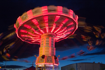 state of oregon: Long exposure of the Oregon State Fair swing ride at night