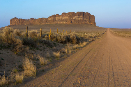 A dirt road leading to Fort Rock, in the high desert of Central Oregon Stock Photo