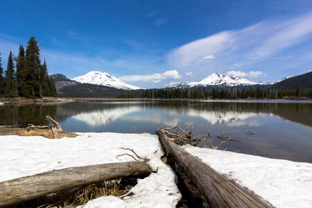View of South Sister and Broken Top from Sparks Lake, Oregon in Springtime Stock Photo