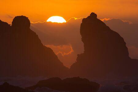 Dramatic sunset at behind ancient seastacks at Bandon on the Southern Oregon coast