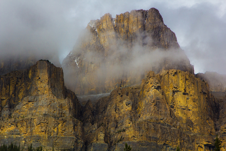 Castle Mountain, Banff National Park, Canada enshrouded in clouds Stock Photo