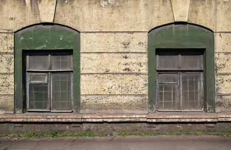 damaged: two old damaged windows