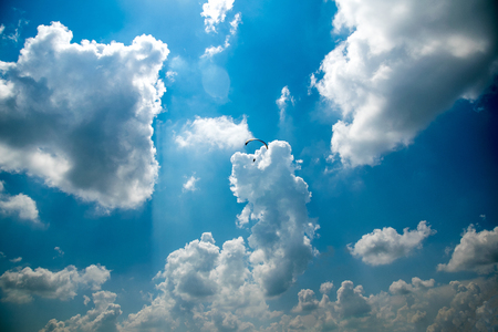 Paraglider in the blue sky, big blue clouds Stock Photo