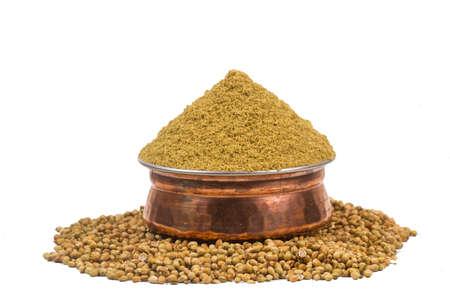 Coriander powder with coriander seeds.