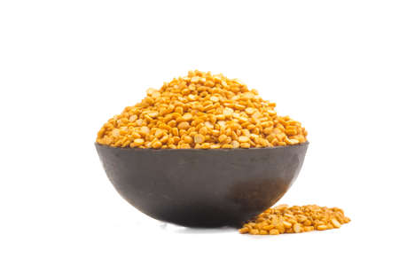 Yellow Lentil isolated on white background.