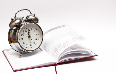 alarm clock and diary on a white background. 免版税图像