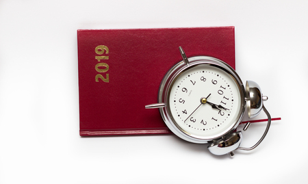 alarm clock and diary on a white background, For time concept.
