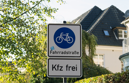 Bicycle and pedestrian lane road sign on pole post. 免版税图像