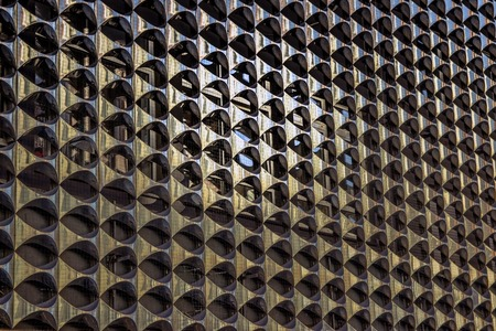 The texture of the metal facade of the building.