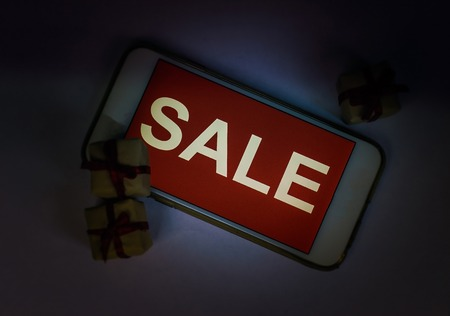 Black friday and sale inscription on smartphone screen.
