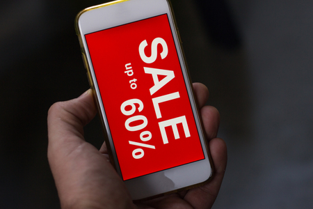 Black friday and sale inscription on smartphone screen. inscription SALES on the screen of a mobile phone.