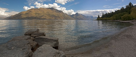 View of the lake from the beach in Queenstown photo