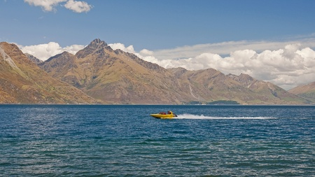Fast boats sail on the lake near Queenstown Stock Photo - 14606160