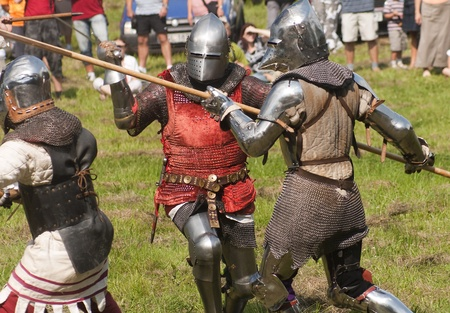 Knights Tournament - demonstration of knights fighting in medieval costumes