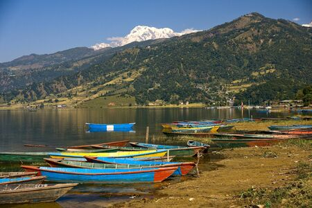 Colorful boats on the lake in Pokhara Stock Photo