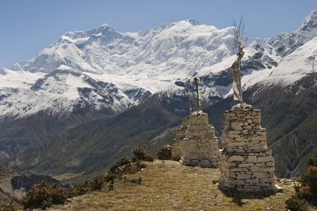 Shrines on the background of snowy peaks in the vicinity of Manang photo