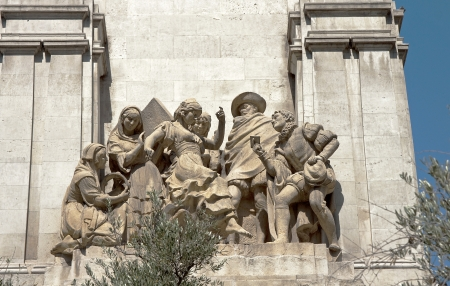 One of the statues on the monument of Don Quixote in Madrid photo