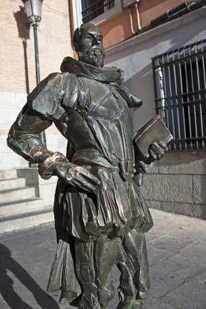 Cervantes bronze statue on one of the squares in Toledo photo