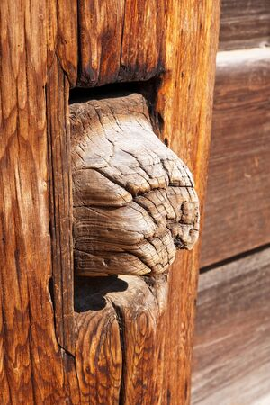 The old way of connecting pieces of wood in architecture photo