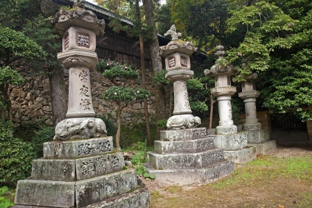 ordeal: Typical old Japanese lanterns are common routes of pilgrimage Stock Photo