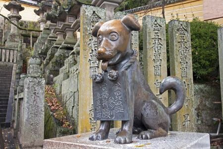 ordeal: The dog - one of the monuments in Kotohira  The dogs were sometimes sent on a pilgrimage to this city, and from that time standing around the temple in Kotohira their monuments