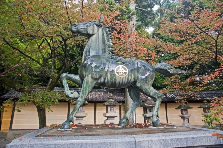 pilgrim journey: Statue of a horse - Kotohira, Japan  View in autumn