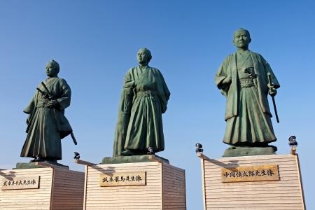 Monument samurai against Kochi railway station - Japan Stock Photo