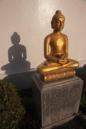 Gold statue of Buddha - view at sunrise