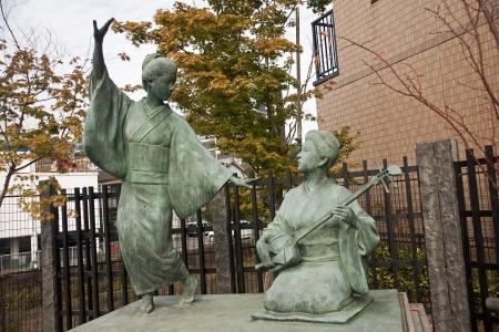 Monument geisha dancing and playing - Kumamoto, Japan Stock Photo