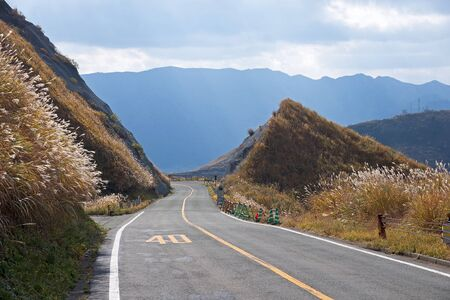 A winding mountain road with a speed limit - area Aso, Japan