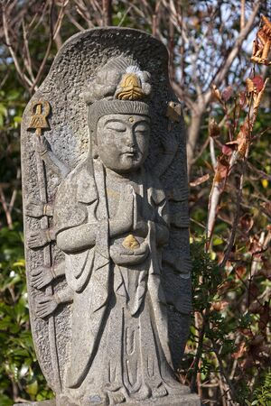 Stone monk - a figure often found in parks at temples Stock Photo