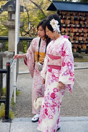 Japanese tourists visitors to the temples in kimonos Editorial