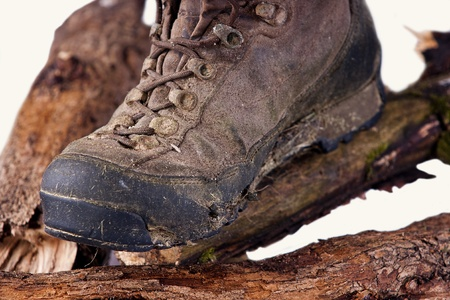 Worn and dirty trekking boots