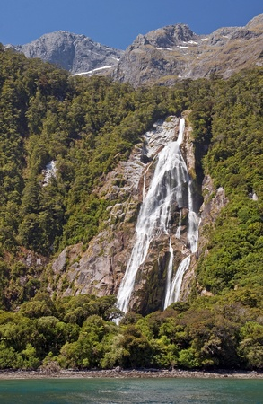 anau: Waterfall at the entrance to the port Mildford Sound