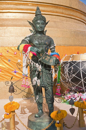 thaiart: Statue at the golden stupa on the top of a Golden Mount in Bangkok Stock Photo