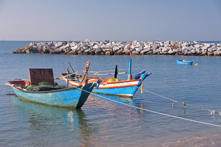 Fishing boats moored in the bay - Rayong, Thailand Stock Photo