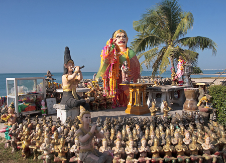 Statues in the seaside temple on the beach in Rayong - Thailand photo